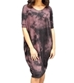 Woman wearing hemp oversize dress in crush color
