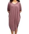 Woman wearing hemp oversize dress in brown
