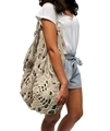 lady wearing beach  bag handmade from sustainable eco-friendly hemp twine