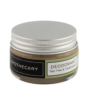 Glass jar containing The Apothecary brand natural deodorant in tea tree and cedarwood scent